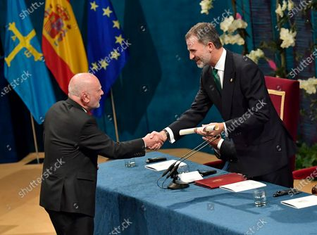 Writer and poet Adam Zagajewski from Poland, left, receives the Princess of Asturias award for Literature, presented by Spanish King Felipe VI, during the Princess of Asturias awards ceremony, in Oviedo, northern Spain. One of Poland's greatest poets, Adam Zagajewski, who wrote a poem that came to symbolize the world's sense of shock and loss after the Sept. 11, 2001, attacks in the United States, died in Krakow on Sunday March 21, 2021, aged 75