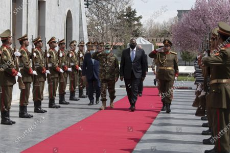 Secretary of Defense Lloyd Austin is welcomed with an honor cordon as he arrives at the presidential palace for a meeting with Afghan President Ashraf Ghani