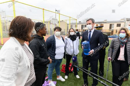 Stock Photo of Roxana Maracineanu, guests, Olivier Veran and Marie Guevenoux.  French Health and Social Affairs Minister Olivier Veran and French Junior Sports Minister Roxana Maracineanu meet an adapted physical activity structure APA de Geants which allows chronically ill people to practice sport in their therapeutic journey.