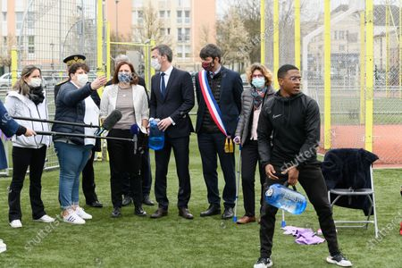 Stock Image of Guests, Roxana Maracineanu, Olivier Veran, Damien Allouch and Marie Guevenoux.  French Health and Social Affairs Minister Olivier Veran and French Junior Sports Minister Roxana Maracineanu meet an adapted physical activity structure APA de Geants which allows chronically ill people to practice sport in their therapeutic journey.