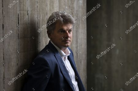 Stock Photo of Fabien Roussel National Secretary of the French Communist Party at the headquarters of the PCF Place du Colonel Fabien Paris, March, 2021.