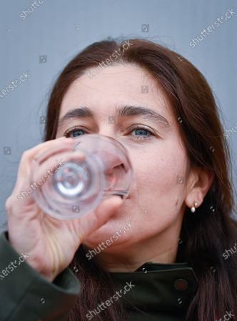 ATTENTION EDITORS - COVERAGE REQUESTED TO BELGA BY AB INBEV - EDITORIAL USE ONLY - Flemish Minister of Environment, Energy, Tourism and Justice Zuhal Demir drinkls water at a visit of the water installation of AB Inbev plant in Leuven, on the world day of water, Monday 22 March 2021.