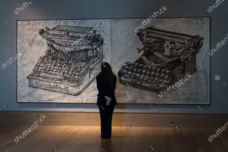 Stock Photo of A staff member looks at William Kentridge (b. 1955) 'Large Typewriters' (2003), estimate: £350,000 - 550,000 during a photo call for Bonhams' 20/21 Century Week - a series of auctions celebrating the last one hundred years in art, on March 22, 2021 in London, England.