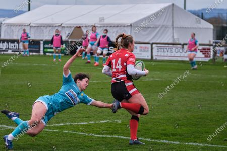 Stock Picture of Kelly Smith (#14 Gloucester-Hartpury) evading a tackle to score