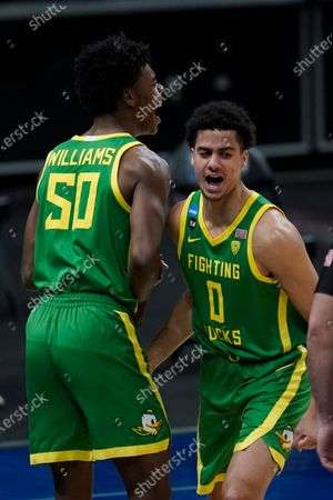 Oregon forward Eric Williams Jr. (50) and Will Richardson (0) celebrate a basket during the first half of a men's college basketball game in the second round of the NCAA tournament at Bankers Life Fieldhouse in Indianapolis