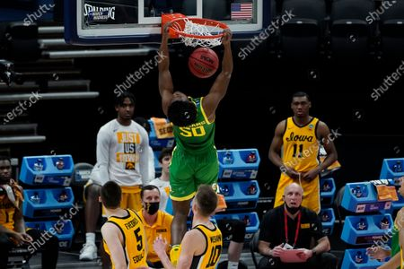 Oregon forward Eric Williams Jr. (50) dunks against Iowa during the first half of a men's college basketball game in the second round of the NCAA tournament at Bankers Life Fieldhouse in Indianapolis