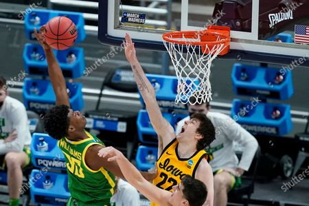 Stock Image of Oregon's Eric Williams Jr. (50) shoots over Iowa's Patrick McCaffery (22) during the second half of a second-round game in the NCAA men's college basketball tournament at Bankers Life Fieldhouse, in Indianapolis