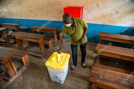 Man votes in the presidential elections at a polling stating in Brazzaville, Congo, . Opposition candidate Guy Brice Parfait Kolelas, running against President Denis Sassou N'Guesso, died shortly after landing in Paris where he was flown to get treatment for Covid-19
