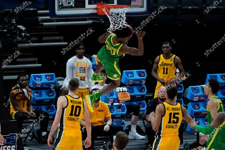 Stock Photo of Oregon forward Eric Williams Jr. (50) dunks against Iowa during the first half of a men's college basketball game in the second round of the NCAA tournament at Bankers Life Fieldhouse in Indianapolis