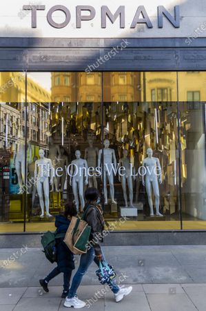 Top Shop on Oxford Street has now been emptied of clothes but the forlorn manequins remain, as do the discount signs and the message (For) The ones we Love on the windows. Many retail units have closed since the pandemic started, including the Arcadia Group which controlled TopSjhop/TopMan.