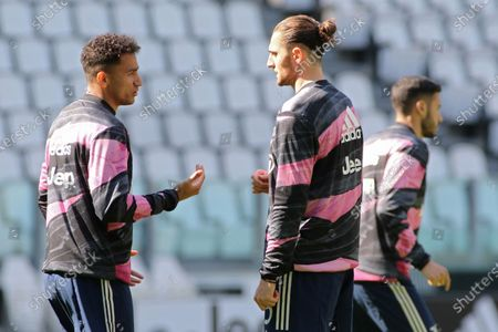 Stock Picture of Danilo Luiz da Silva (Juventus FC) and Adrien Rabiot (Juventus FC) dispute during warmup