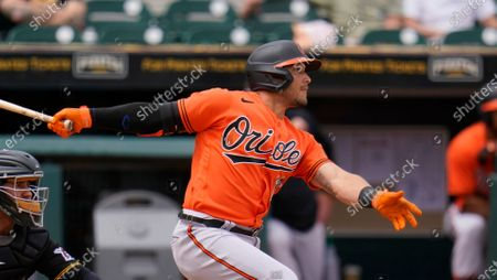 Baltimore Orioles' Yolmer Sanchez bats during a spring training exhibition baseball game against the Pittsburgh Pirates in Bradenton, Fla