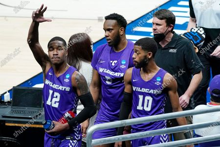 Abilene Christian's Mahki Morris (12) waves to fans as he leaves the court with Airion Simmons, center, Reggie Miller (10) and head coach Joe Golding, top right, after their 67-47 loss to UCLA in a college basketball game during the second round of the NCAA tournament at Bankers Life Fieldhouse in Indianapolis