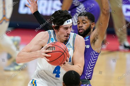 UCLA's Jaime Jaquez Jr. (4) drives against Abilene Christian's Reggie Miller during the first half of a college basketball game in the second round of the NCAA tournament at Bankers Life Fieldhouse in Indianapolis