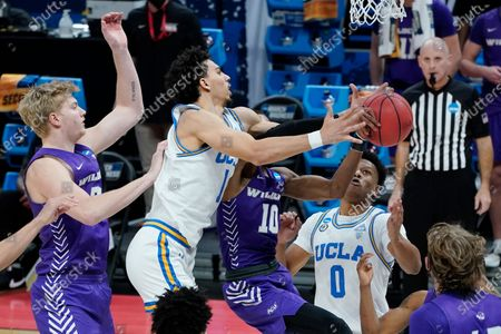 UCLA's Jules Bernard (1) reaches for a rebound between Abilene Christian's Kolton Kohl, left, and Reggie Miller (10) during the first half of a college basketball game in the second round of the NCAA tournament at Bankers Life Fieldhouse in Indianapolis