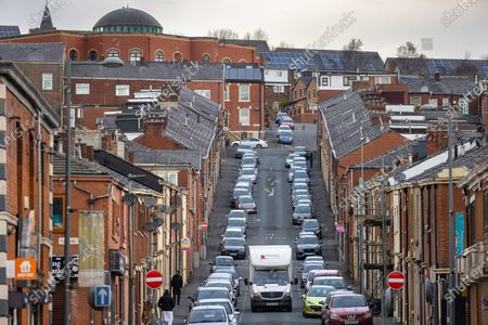 Stock Photo of A view along a steeply sloping terraced street as seen from Barbara Castle Way . Exploring a year of experiences , lessons and consequences of Coronavirus in the NW of England .