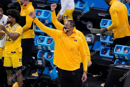 Michigan head coach Juwan Howard celebrates at the end of a second-round game against LSU in the NCAA men's college basketball tournament at Lucas Oil Stadium, in Indianapolis. Michigan won 86-78