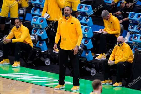 Michigan head coach Juwan Howard watches from the bench during the first half of a second-round game against LSU in the NCAA men's college basketball tournament at Lucas Oil Stadium, in Indianapolis