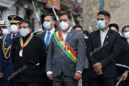 Bolivia's President Luis Arce (C) and Vice President David Choquehuanca (L) attend the commemoration of the Day of the Sea marking 142 years since Bolivia lost around 120,000 kilometers of its coastline to Chile in the War of the Pacific, in La Paz, Bolivia, 22 March 2021. The anniversary falls on 23 March.