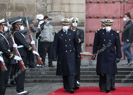 An escort from the Navy moves the urn with the remains of Eduardo Abaroa, war hero from the 1879 Battle of Topater, during the commemoration of the Day of the Sea marking 142 years since Bolivia lost around 120,000 kilometers of its coastline to Chile in the War of the Pacific, in La Paz, Bolivia, 22 March 2021. The anniversary falls on 23 March.
