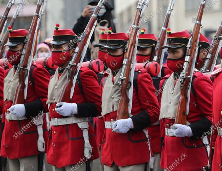 Members of the Colorados Regiment of Bolivia, the country's Presidential Guard, attend the commemoration of the Day of the Sea marking 142 years since Bolivia lost around 120,000 kilometers of its coastline to Chile in the War of the Pacific, in La Paz, Bolivia, 22 March 2021. The anniversary falls on 23 March.