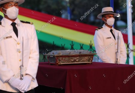 An escort from the Navy guards the urn with the remains of Eduardo Abaroa, war hero from the 1879 Battle of Topater, during the commemoration of the Day of the Sea marking 142 years since Bolivia lost around 120,000 kilometers of its coastline to Chile in the War of the Pacific, in La Paz, Bolivia, 22 March 2021. The anniversary falls on 23 March.