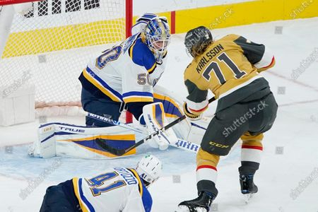 Vegas Golden Knights center William Karlsson (71) scores on St. Louis Blues goaltender Jordan Binnington (50) during the third period of an NHL hockey game, in Las Vegas