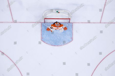 Philadelphia Flyers' Brian Elliott plays during an NHL hockey game against the New York Islanders, in Philadelphia