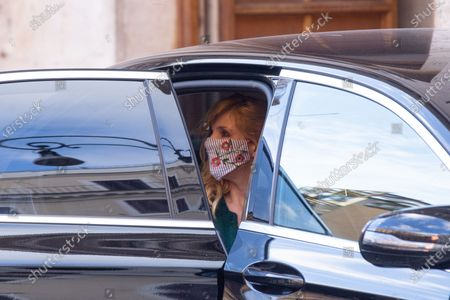 "British actress Kelly Reilly gets into the car after finishing shooting the film. The Italian actor Pierfrancesco Favino and the English actress Kelly Reilly in Rome during the shooting of the film ""Promises"" directed by the French director and writer Amanda Sthers."
