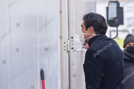 The Italian actor Pierfrancesco Favino enters his dressing room after the shooting of the film