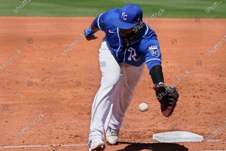 Kansas City Royals first baseman Carlos Santa reaches for a throw during a spring training baseball game against the San Diego Padres, in Surprise, Ariz