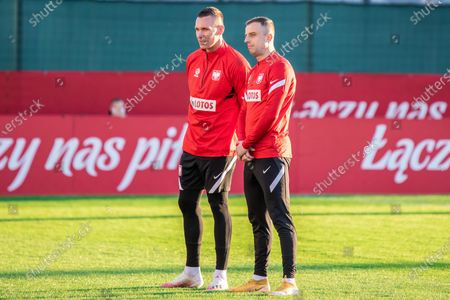 Lukasz Skorupski (L) and Kamil Grosicki (R) of Poland are seen in action during the first official training session of the Polish national football team in 2021.