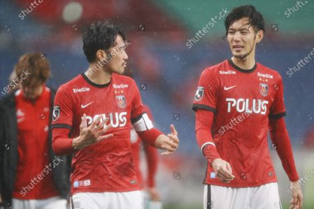 Stock Photo of (L-R) Yuki Abe, Kenyu Sugimoto (Reds) - Football / Soccer :  2021 J1 League match between Urawa Red Diamonds 0-5 Kawasaki Frontale at Saitama Stadium 2002, Saitama, Japan.