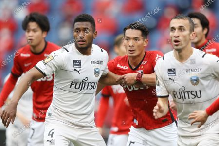 (L-R) Jesie (Frontale), Tomoaki Makino (Reds), Joao Schmidt (Frontale) - Football / Soccer :  2021 J1 League match between Urawa Red Diamonds 0-5 Kawasaki Frontale at Saitama Stadium 2002, Saitama, Japan.