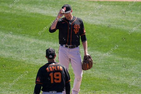 Stock Photo of San Francisco Giants manager Gabe Kapler (19) comes out to visit with starting pitcher Kevin Gausman during the fourth inning of a spring training baseball game against the Chicago White Sox, in Phoenix