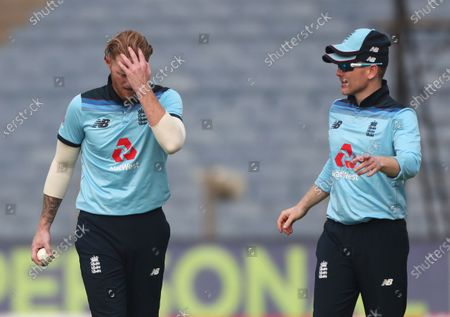 England's Ben Stokes, left, listens to captain Eoin Morgan before bowling his next delivery during the first One Day International cricket match between India and England at Maharashtra Cricket Association Stadium in Pune, India