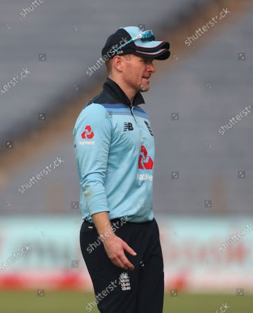 England's captain Eoin Morgan leaves the field after injuring his hand during the first One Day International cricket match between India and England at Maharashtra Cricket Association Stadium in Pune, India