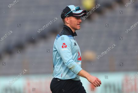 England's captain Eoin Morgan leaves the field after injuring his right hand during the first One Day International cricket match between India and England at Maharashtra Cricket Association Stadium in Pune, India