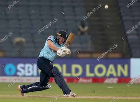 England's captain Eoin Morgan plays a shot during the first One Day International cricket match between India and England at Maharashtra Cricket Association Stadium in Pune, India