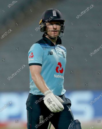 England's captain Eoin Morgan walks off the field after losing his wicket during the first One Day International cricket match between India and England at Maharashtra Cricket Association Stadium in Pune, India
