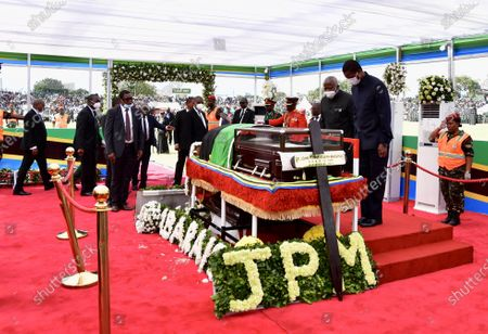 Zambian President Edgar Lungu (2nd R) pays his respect to former Tanzanian President John Magufuli in Dodoma, capital of Tanzania, on March 22, 2021. Tanzania held a state funeral for John Magufuli at the Jamhuri Stadium in Dodoma on Monday, with the attendance of African leaders, representatives and other dignitaries. Magufuli, 61, died in office from a heart condition on March 17 in the country's commercial capital Dar es Salaam.