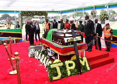 Mozambican President Filipe Nyusi (3rd R) pays his respect to former Tanzanian President John Magufuli in Dodoma, capital of Tanzania, on March 22, 2021. Tanzania held a state funeral for John Magufuli at the Jamhuri Stadium in Dodoma on Monday, with the attendance of African leaders, representatives and other dignitaries. Magufuli, 61, died in office from a heart condition on March 17 in the country's commercial capital Dar es Salaam.