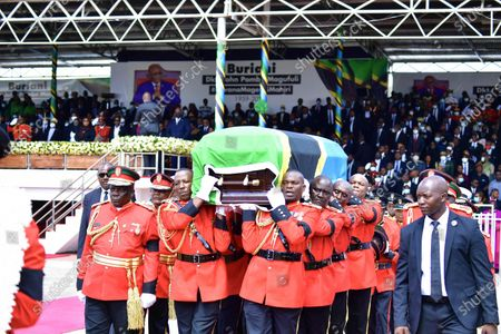 Soldiers carry the casket of former Tanzanian President John Magufuli in Dodoma, capital of Tanzania, on March 22, 2021. Tanzania held a state funeral for John Magufuli at the Jamhuri Stadium in Dodoma on Monday, with the attendance of African leaders, representatives and other dignitaries. Magufuli, 61, died in office from a heart condition on March 17 in the country's commercial capital Dar es Salaam.