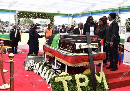 Tanzanian President Samia Suluhu Hassan (2nd R, Front) pays her respect to former Tanzanian President John Magufuli in Dodoma, capital of Tanzania, on March 22, 2021. Tanzania held a state funeral for John Magufuli at the Jamhuri Stadium in Dodoma on Monday, with the attendance of African leaders, representatives and other dignitaries. Magufuli, 61, died in office from a heart condition on March 17 in the country's commercial capital Dar es Salaam.