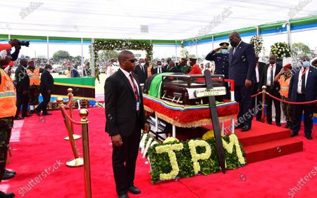 Stock Picture of President Felix Tshisekedi (front on podium) of the Democratic Republic of the Congo (DRC) pays his respect to former Tanzanian President John Magufuli in Dodoma, capital of Tanzania, on March 22, 2021. Tanzania held a state funeral for John Magufuli at the Jamhuri Stadium in Dodoma on Monday, with the attendance of African leaders, representatives and other dignitaries. Magufuli, 61, died in office from a heart condition on March 17 in the country's commercial capital Dar es Salaam.
