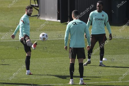 Portugal soccer team players (L-R), Bruno Fernandes, Cristiano Ronaldo, and Renato Sanches, in action during a training session in Juventus training center in Turin, Italy, 23 March 2021. Portugal will face Azerbaijan in their 2022 FIFA World Cup qualification UEFA Group A soccer match on 24 March 2021.