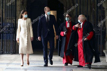 Britain's Prince William and Kate, Duchess of Cambridge, with Dean of Westminster The Very Reverend Dr David Hoyle, right, and Paul Baumann, Receiver General and Chapter Clerk arrive for a visit to the vaccination center at Westminster Abbey, London, to pay tribute to the efforts of those involved in the Covid-19 vaccine rollout. The U.K. is marking a national day of reflection Tuesday a year after British Prime Minister Boris Johnson first announced that the country would go into lockdown to slow the fast-spreading coronavirus