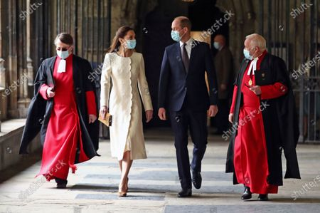 Britain's Prince William and Kate, Duchess of Cambridge with Dean of Westminster The Very Reverend Dr David Hoyle, right, and Paul Baumann, Receiver General and Chapter Clerk arrive for a visit to the vaccination center at Westminster Abbey, London, to pay tribute to the efforts of those involved in the Covid-19 vaccine rollout. The U.K. is marking a national day of reflection Tuesday a year after British Prime Minister Boris Johnson first announced that the country would go into lockdown to slow the fast-spreading coronavirus