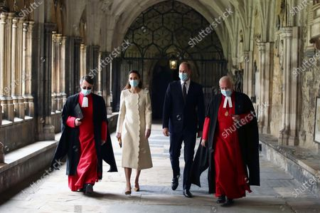 Britain's Prince William and Kate, Duchess of Cambridge with Dean of Westminster The Very Reverend Dr David Hoyle, right, and Paul Baumann, Receiver General and Chapter Clerk, arrive for a visit to the vaccination center at Westminster Abbey, London, to pay tribute to the efforts of those involved in the Covid-19 vaccine rollout. The U.K. is marking a national day of reflection Tuesday a year after British Prime Minister Boris Johnson first announced that the country would go into lockdown to slow the fast-spreading coronavirus