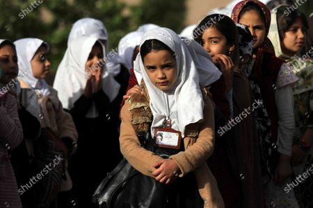 Afghan school girls attend the first day of the academic year at their school after the educational institutes opened in Herat, Afghanistan, 23 March 2021. The new school year in Afghanistan began on 23 March as President Ashraf Ghani saying at least one million more students will attend classes on the new year. According to UNICEF, an estimated 3.7 million children are out-of-school in Afghanistan, 60 percent of them being girls.